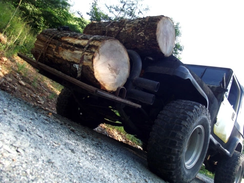 jenny the jeep hauling logs 2