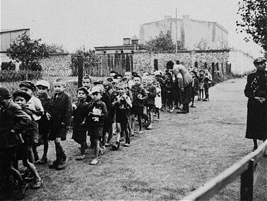 Jewish children of Litzmannstadt Ghetto of Łódź Poland being brought to Chełmno Nazi extermination camp
