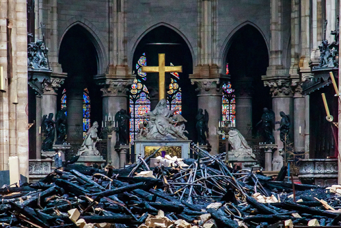 notre dame france fire cross pieta